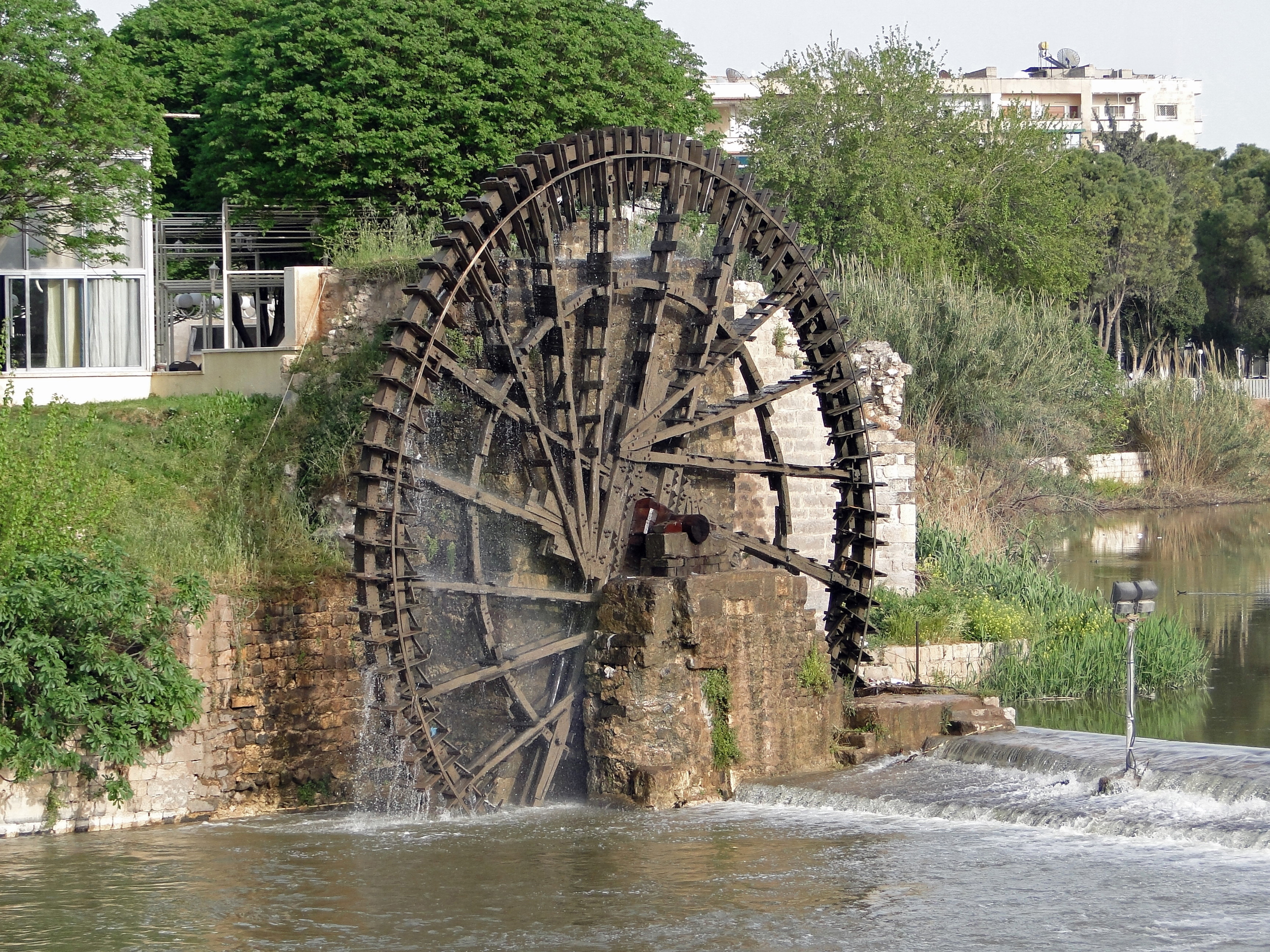 hama water wheels Hama is famous for these water wheels, initially built by the romans in what must be one of the most impressive engineering feats i've seen in a while the current turns the wheels which contain small buckets which fill up with water and then spill out over to the aqueduct to its side.