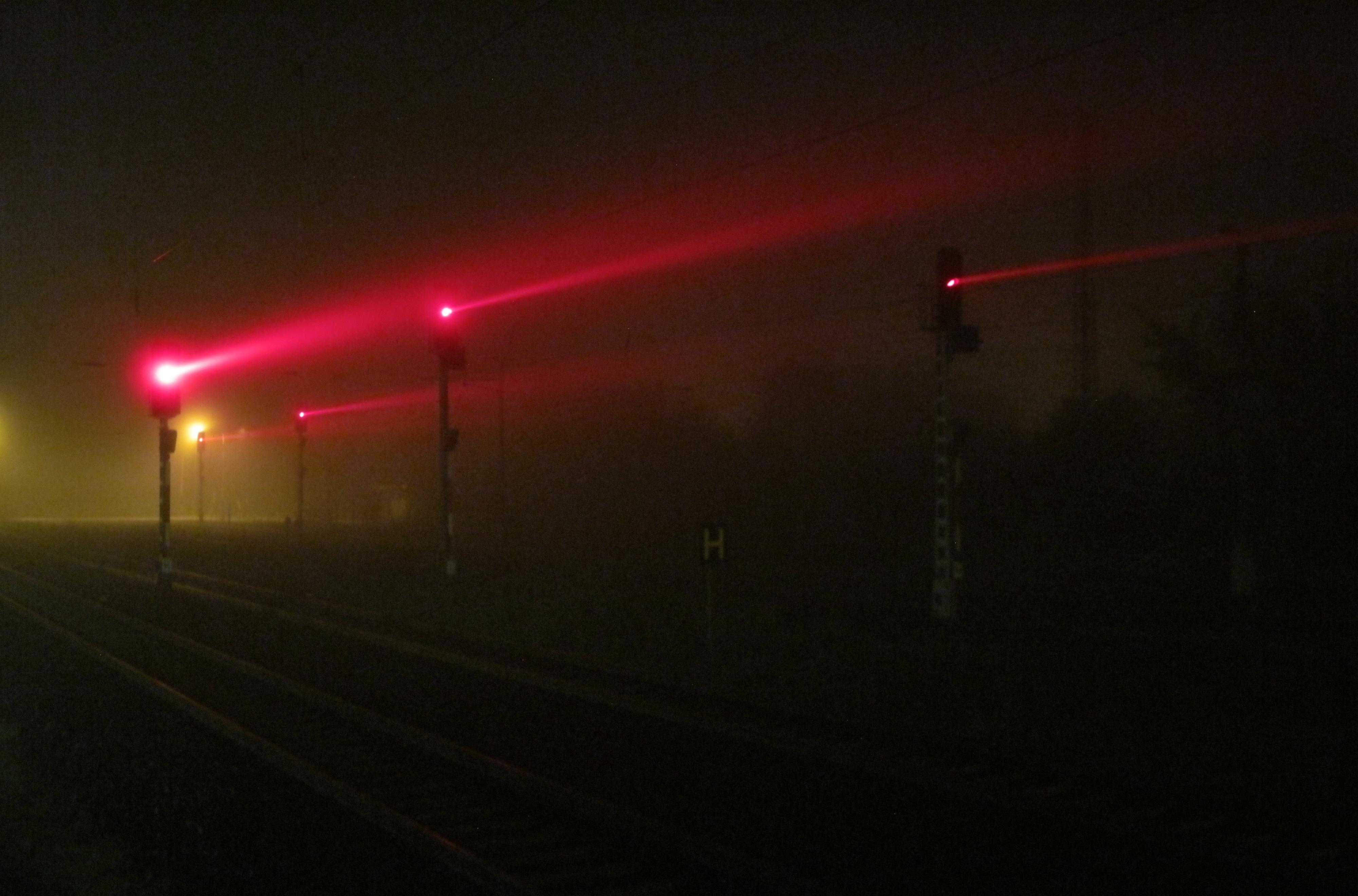 File:Railway signals beaming through ground fog at night jpg