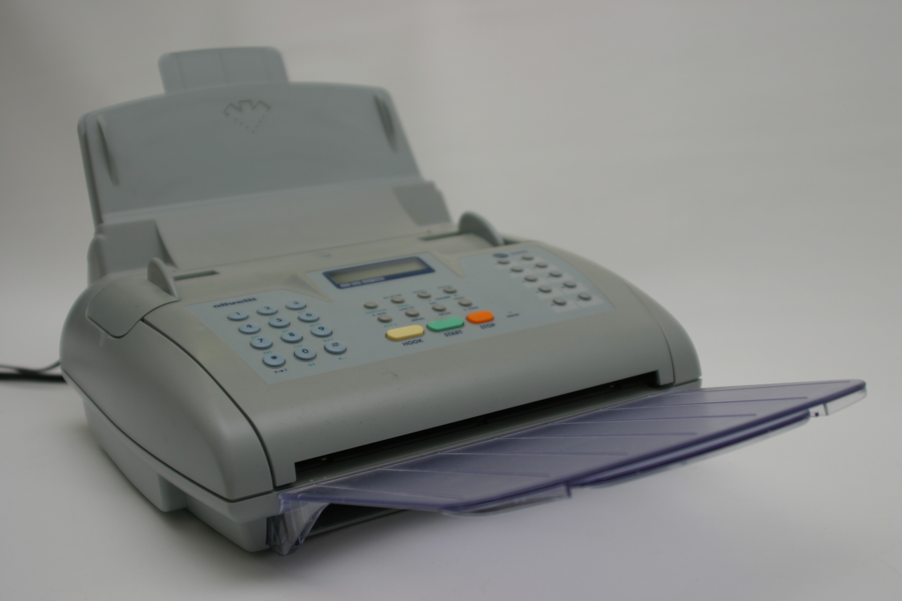 Olivetti fax machine sitting at an angle.