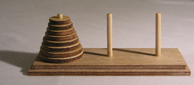 [Towers of Hanoi: one peg with 8 rings, two empty pegs]