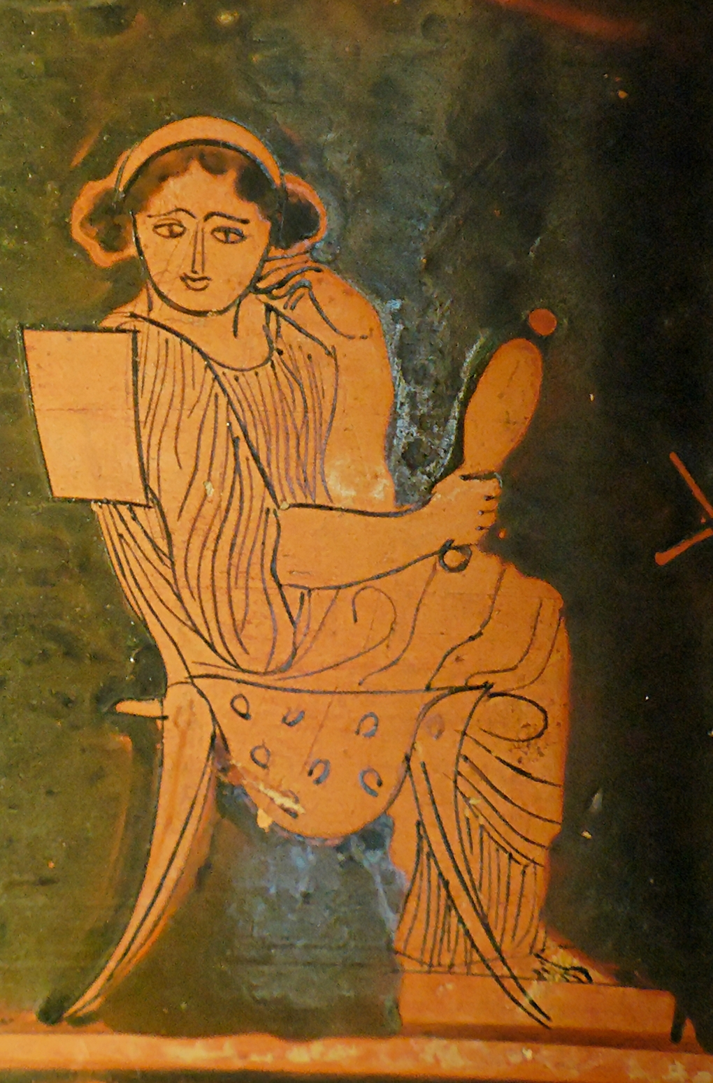 Woman holding a mirror. Attic red-figure pyxis...