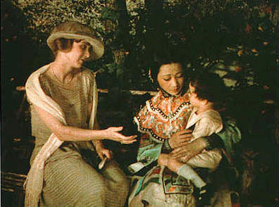 Anna May Wong holds child in The Toll of the Sea