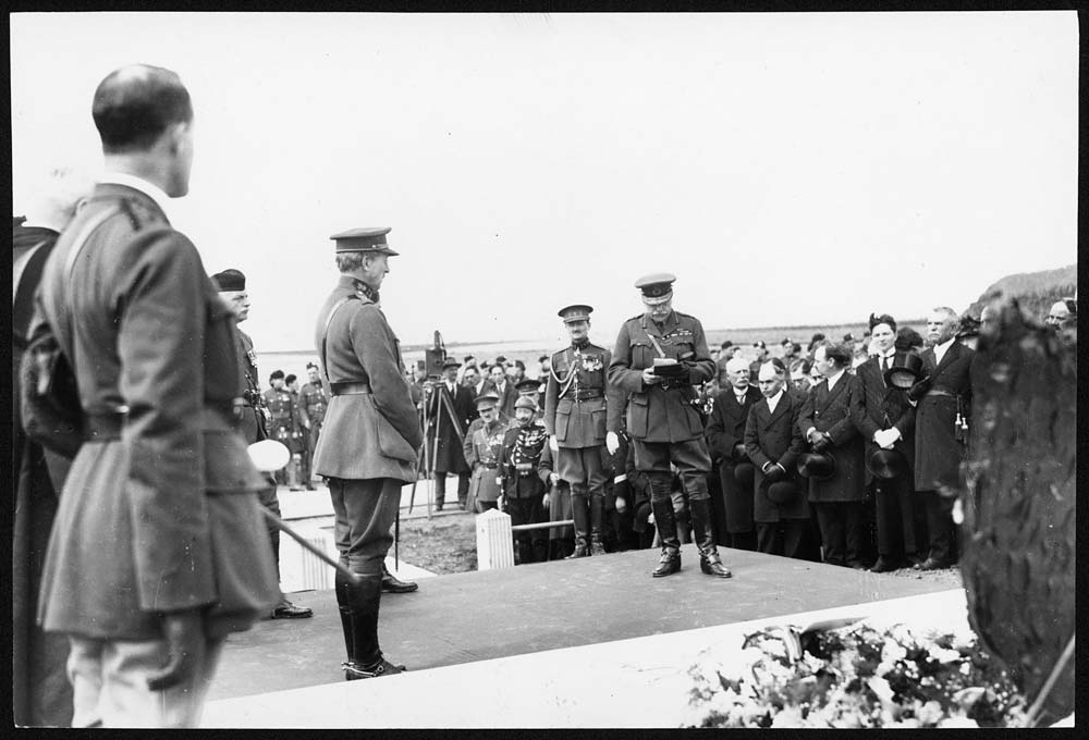 Unveiling of memorial, Messines, Belgium, after World War I. This is one of two photographs of Field Marshal (Earl) Haig (1861-1928) at the unveiling of the memorial of the London Scottish Regiment at Messines, Belgium. It shows Haig talking to the Belgian king, Albert I (1875-1934). They appear to be walking away after the ceremony.The London Scottish Regiment was the first Territorial regiment in action at the Battle of Messines on 31 October 1914. [Original reads: 'UNVEILING OF THE MEMORIAL CROSS OF THE LONDON SCOTTISH REGIMENT BY H.M. THE KING OF THE BELGIANS AT MESSINES, BELGIUM. Earl Haig replying to the King of the Belgians and thanking him for unveiling the Memorial.'] http://digital.nls.uk/74549682