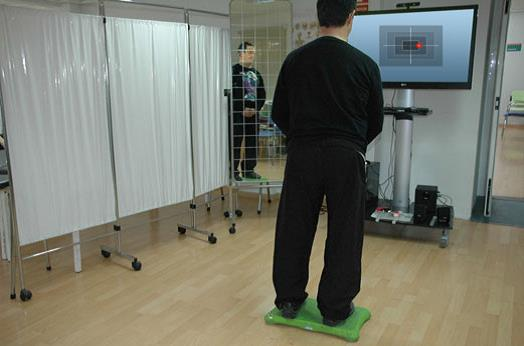File:Patient on balance board for rehabilitation.jpg