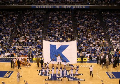 "The Kentucky cheerleaders at Rupp Arena performing the traditional ""Big K"" cheer during a basketball game. Seating Capacity of Rupp Arena is 23,500. RupparenaK.JPG"