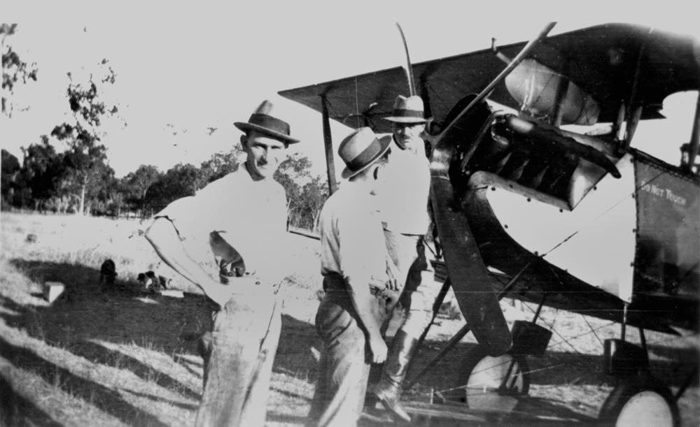 file statelibqld 1 165703 men standing at front of an aeroplane