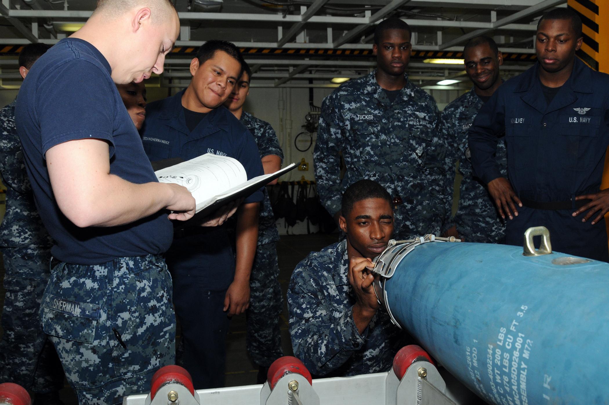 File:USS George H W  Bush sailors train 120620-N-TU894-015