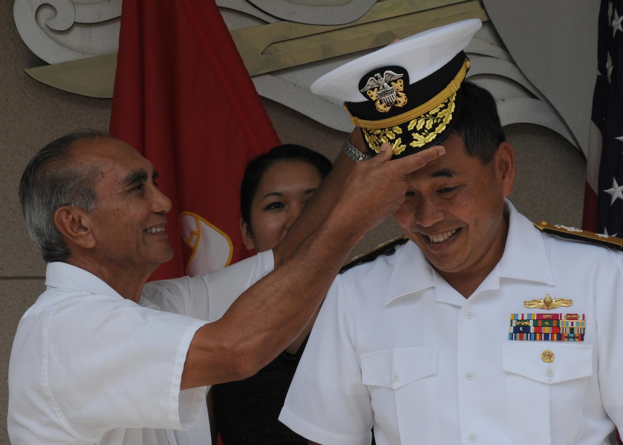 098a6e4276e73c File:US Navy 090911-N-0569T-212 Rear Adm. Peter Gumataotao receives ...