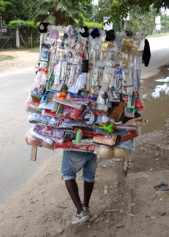 File:Vendor Bearing Wares - Oyster Bay District - Dar es Salaam