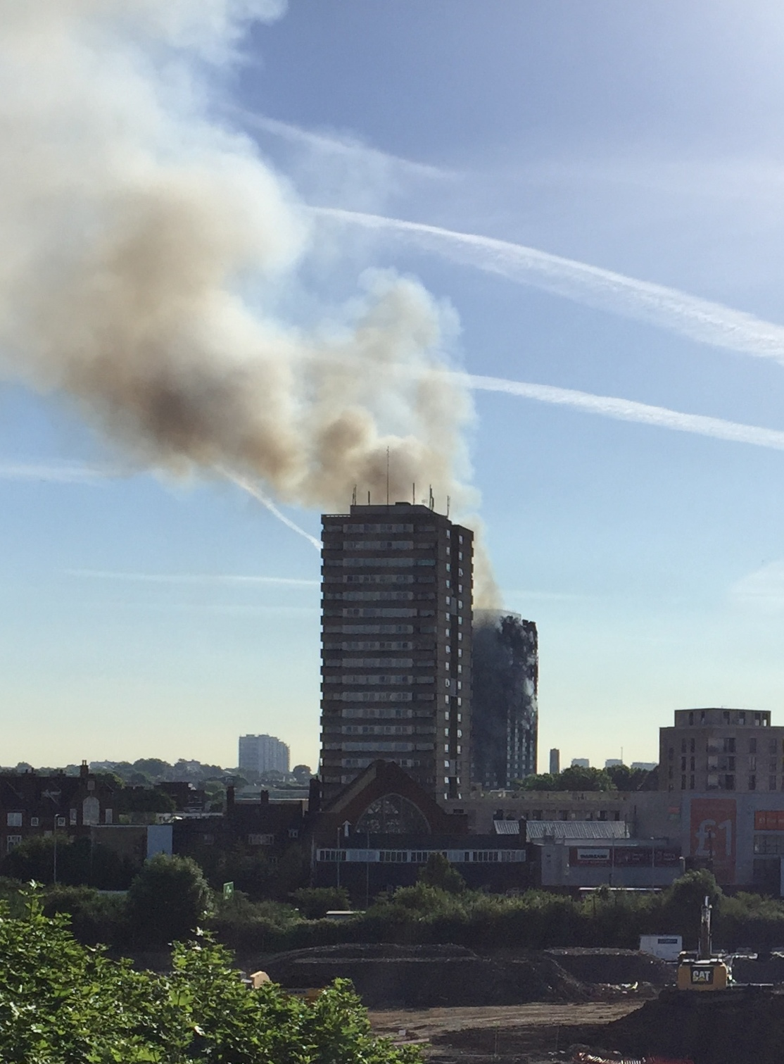 In The Morning Smoke Plume Was Still Visible Over A Long Distance Grenfell Tower Is Building Behind Frinstead House Front