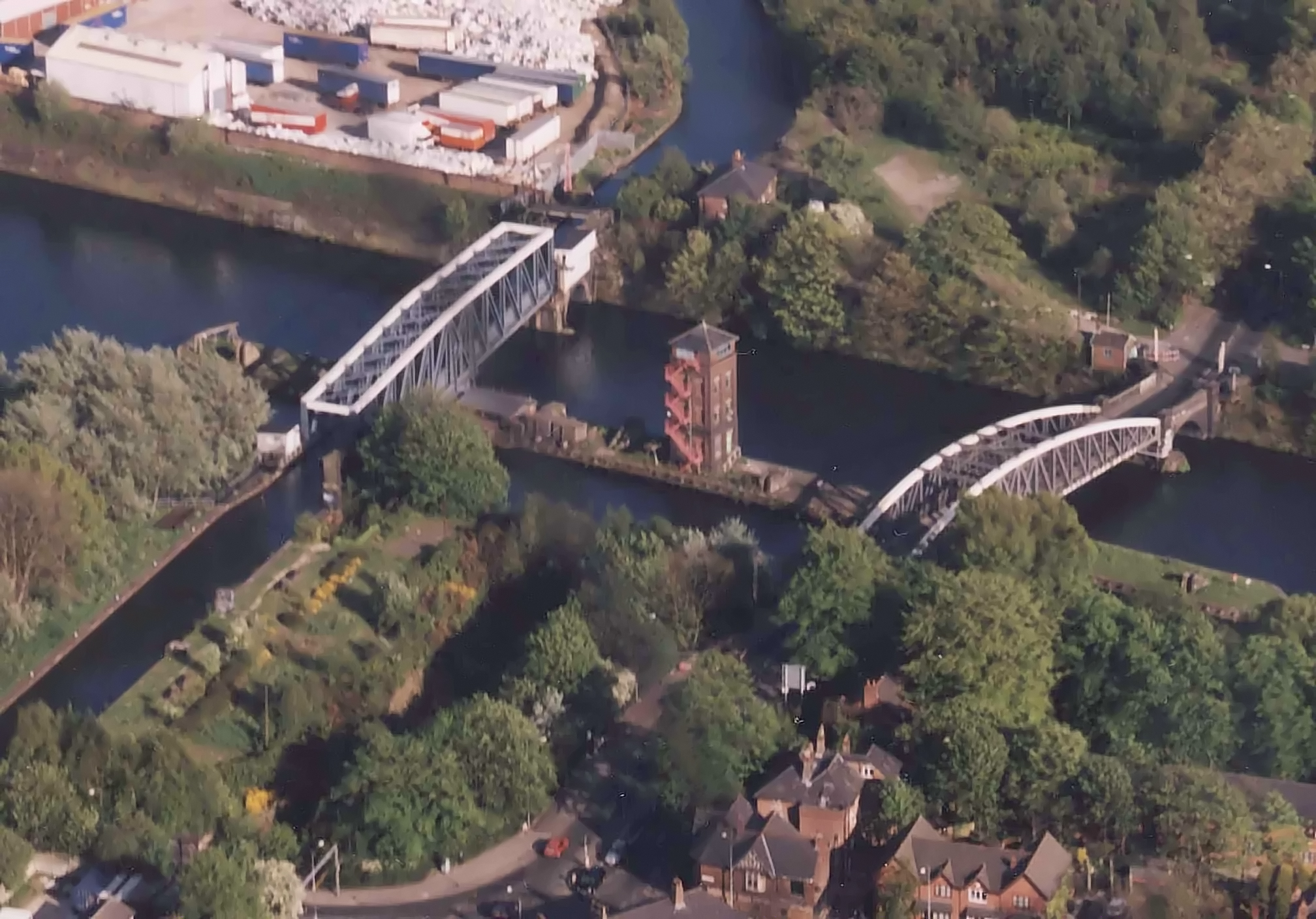 The swing aqueduct in the closed position, showing the Bridgewater Canal crossing over the Ship Canal. The Barton Road Swing Bridge is on the right.