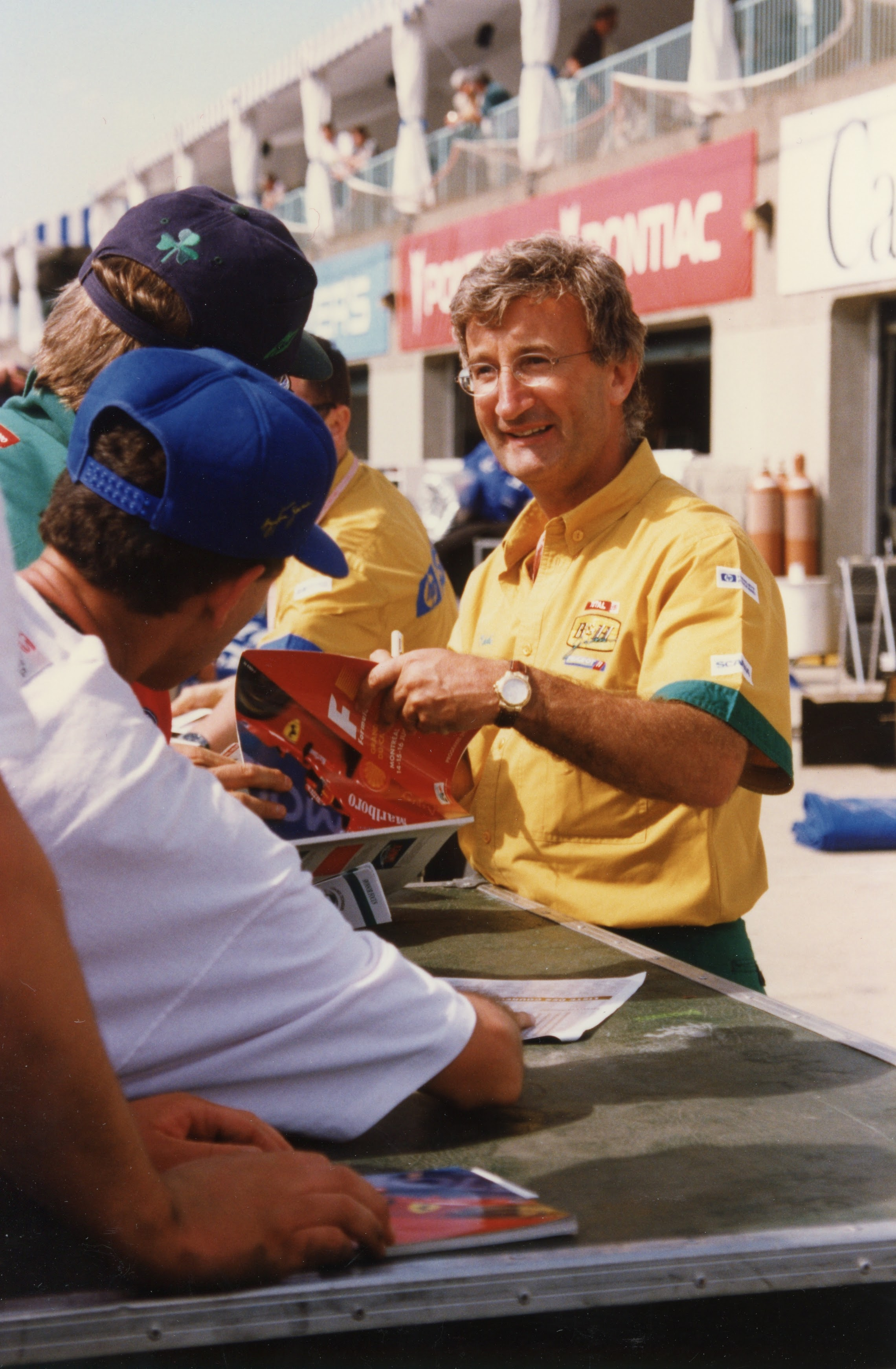 Eddie Jordan, founder and owner of Jordan Grand Prix, greets the fans in Montreal in 1996