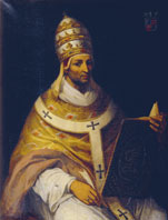 Painting of a young cleanshaven man wearing golden robes and a tall conical hat with elaborate designs.  He is holding a large book in his lap, but looking towards the viewer.
