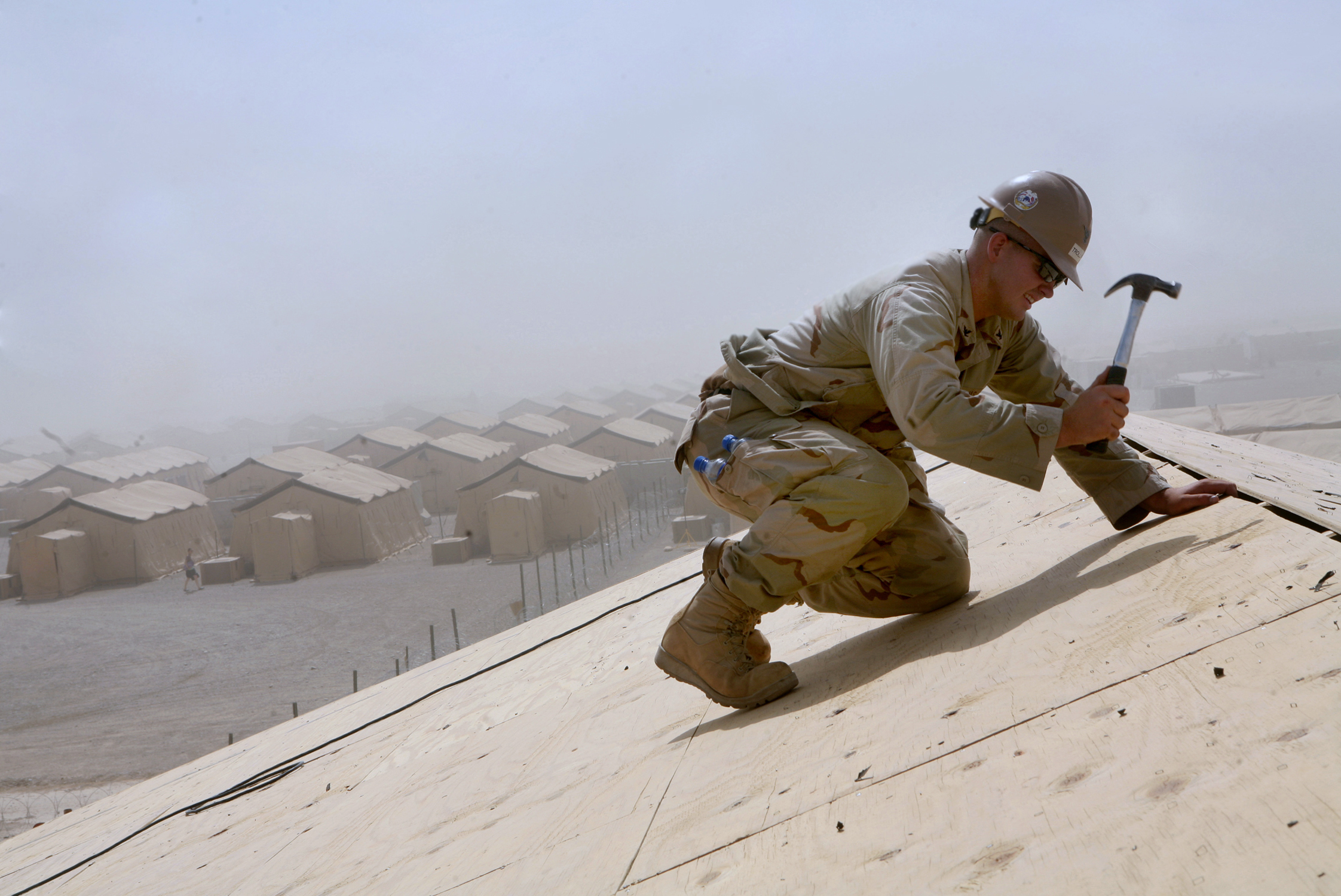 File:US Navy 090513-M-6882R-162 Builder 3rd Class Adrian Trollip works on the roof of the Marine ...