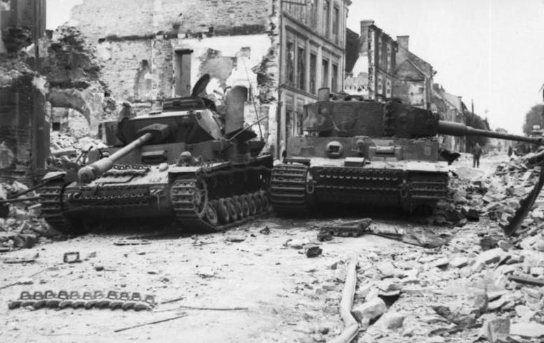 A Tiger I and a Pzkpfw IV knocked out,  close to the town's center