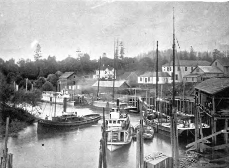 A waterfront in Oregon with ships sailing and docked