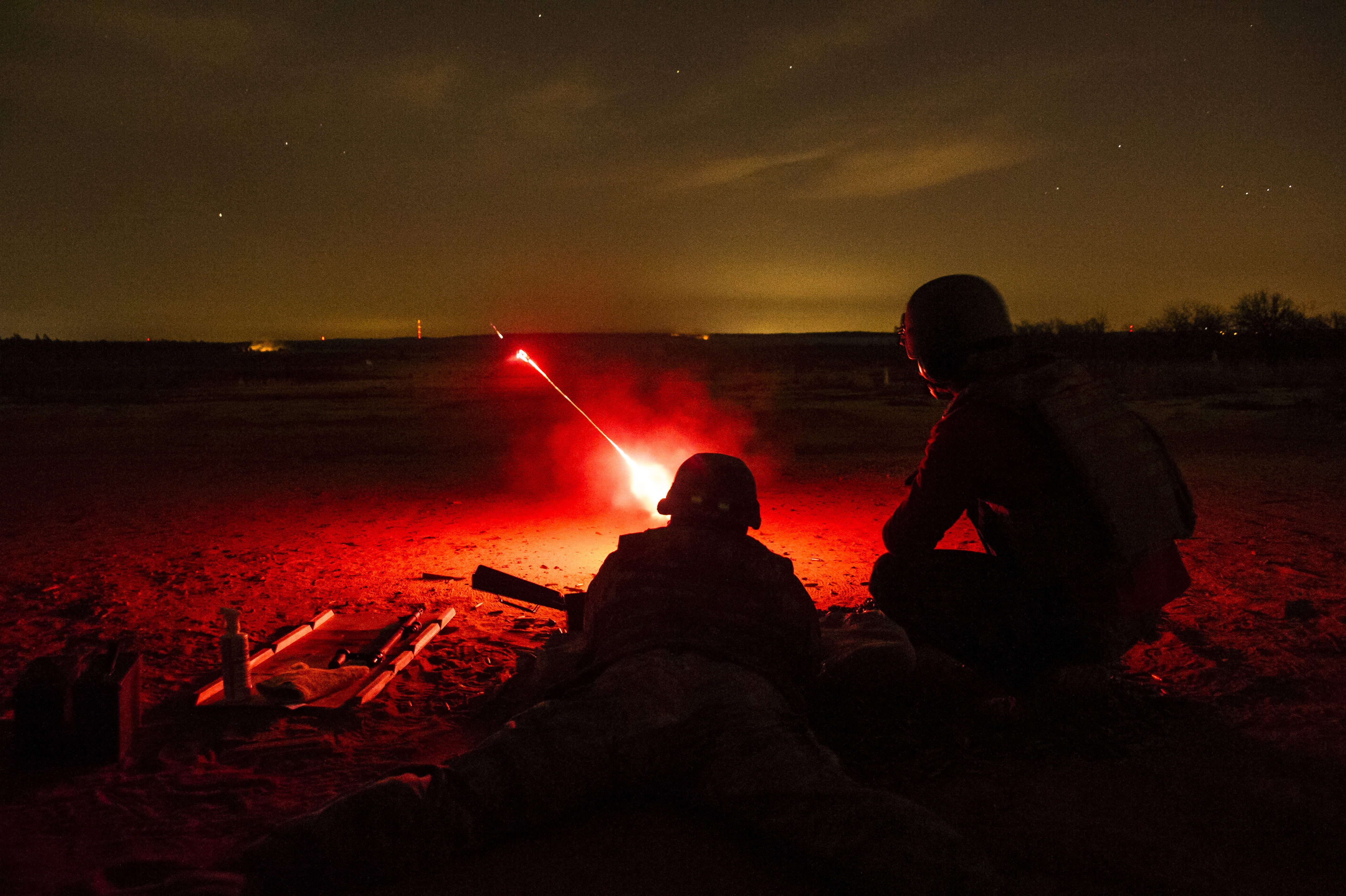 Machine Gun Fire : File red tracers light up the night as members of