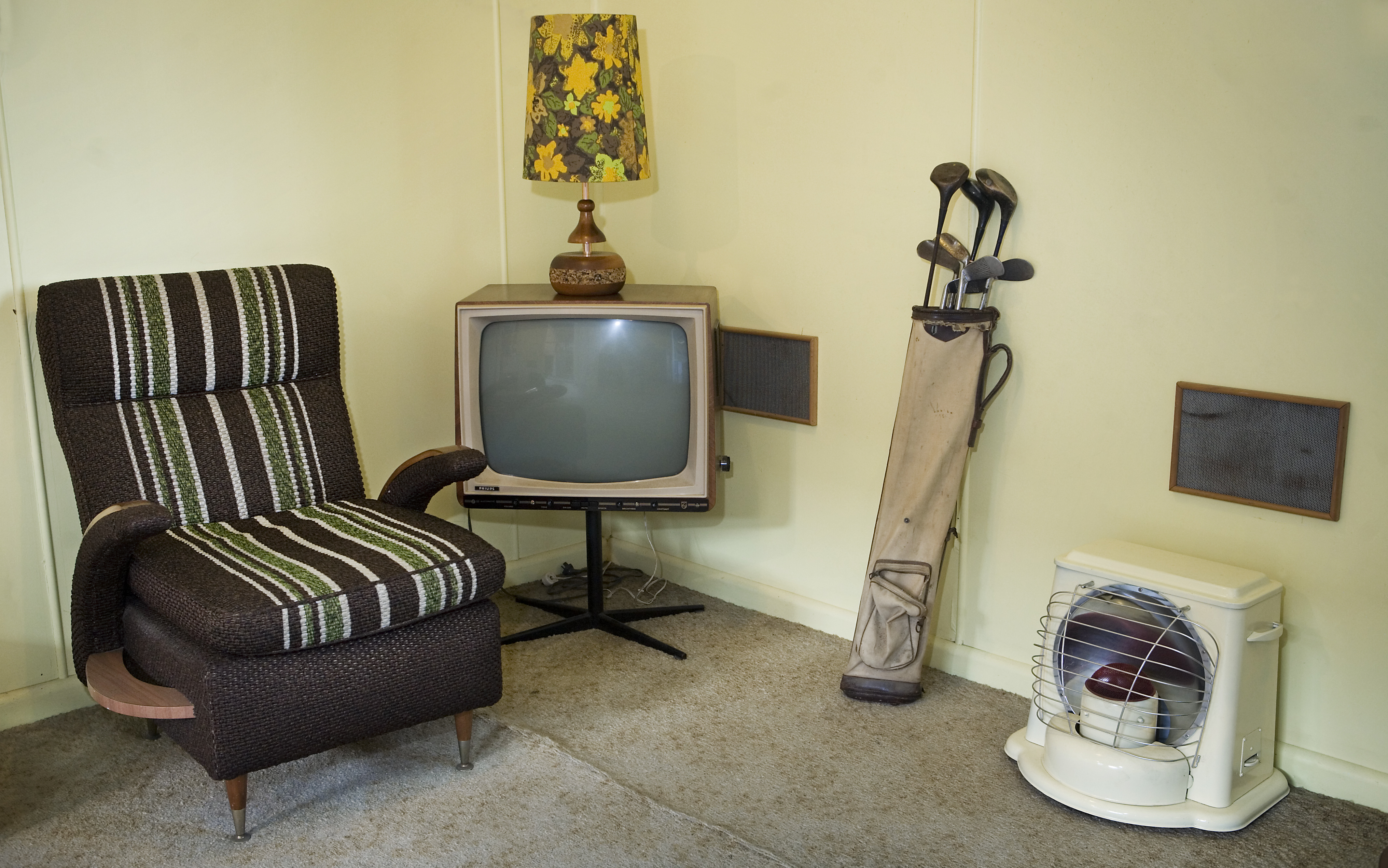 FileTV set Golf clubs and other furniture in a beach house