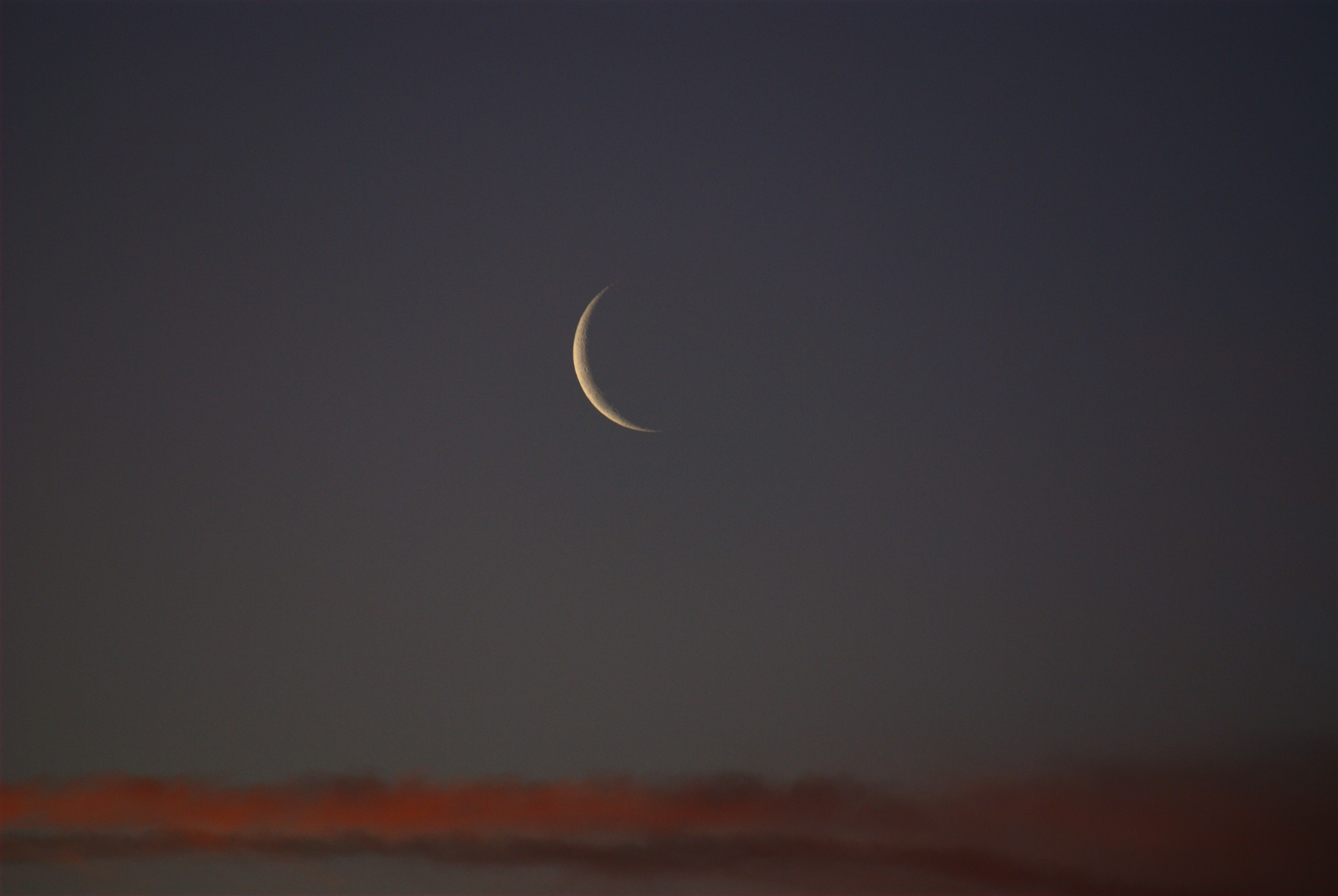 File:New Moon at sunse...