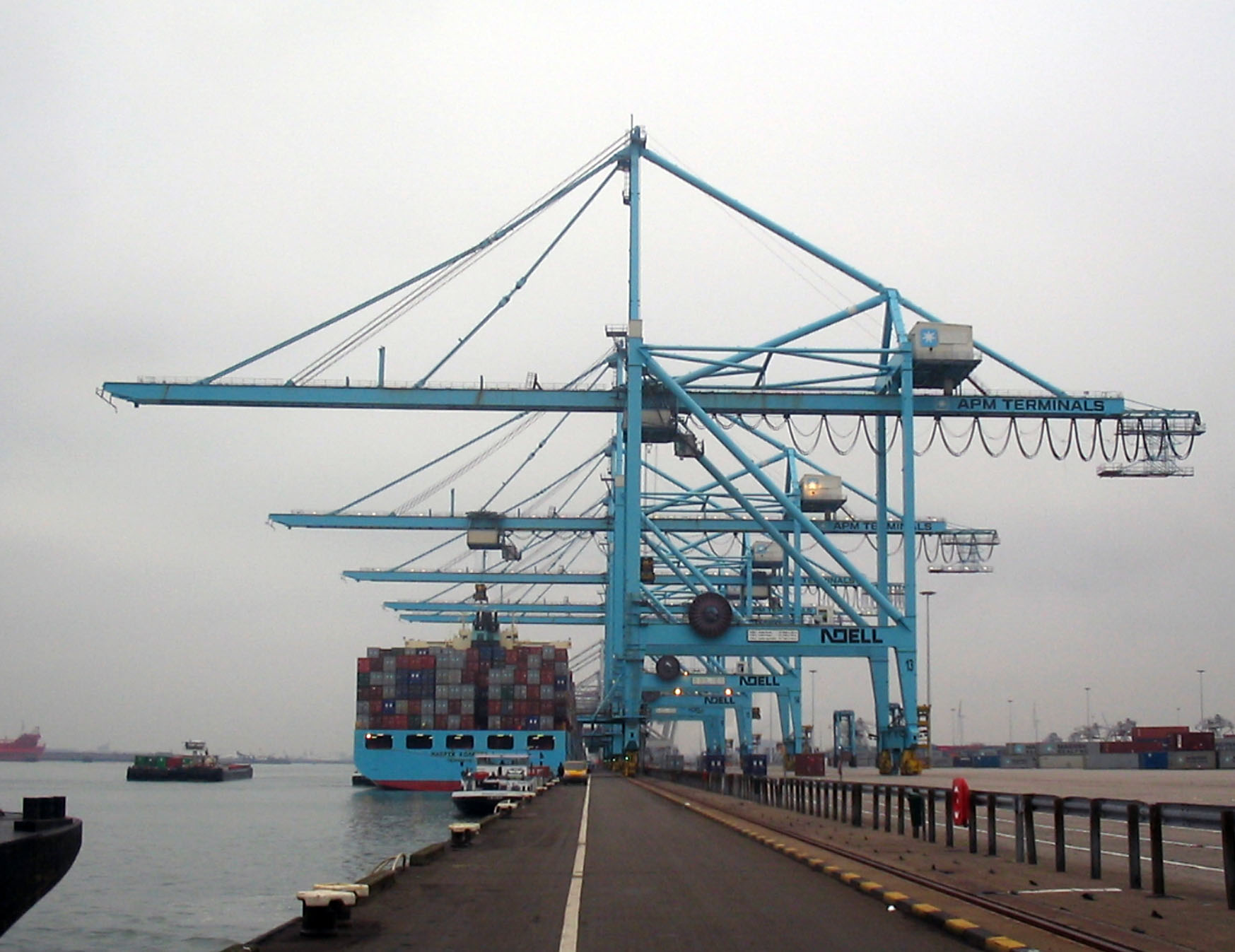 Super-PostPanamax cranes in Port of Rotterdam, these overhang by 50m (22 rows of containers).