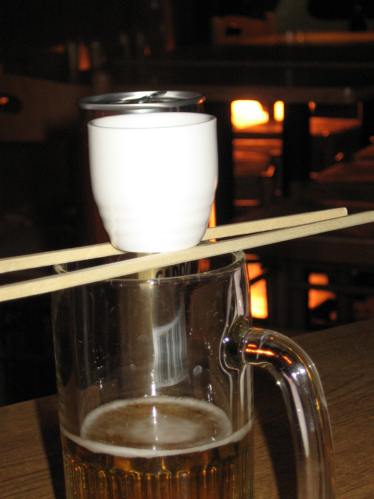 File:Sake bomb using chopsticks to support the shotglass ...