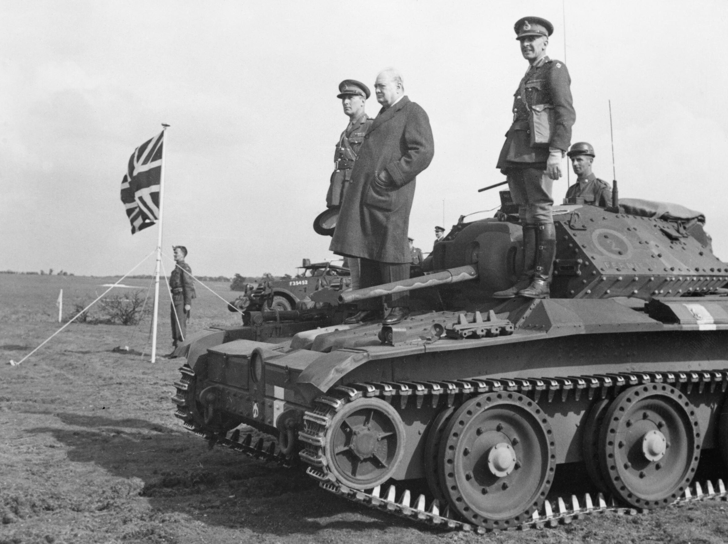Winston_Churchill_stands_on_a_Covenanter_tank_of_4th-7th_Royal_Dragoon_Guards%2C_to_take_the_salute_at_an_inspection_of_9th_Armoured_Division_near_Newmarket%2C_Suffolk%2C_16_May_1942._H19765.jpg