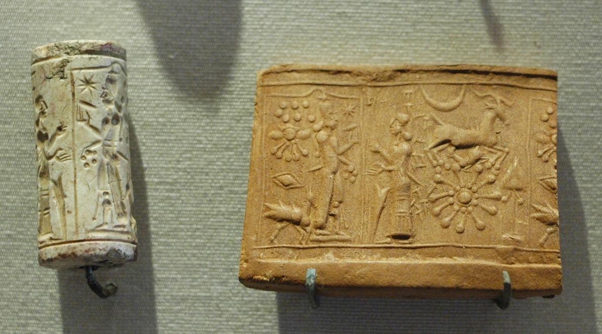 the worship of the sun-god, Shamash. Limestone cylinder-seal, Mesopotamia