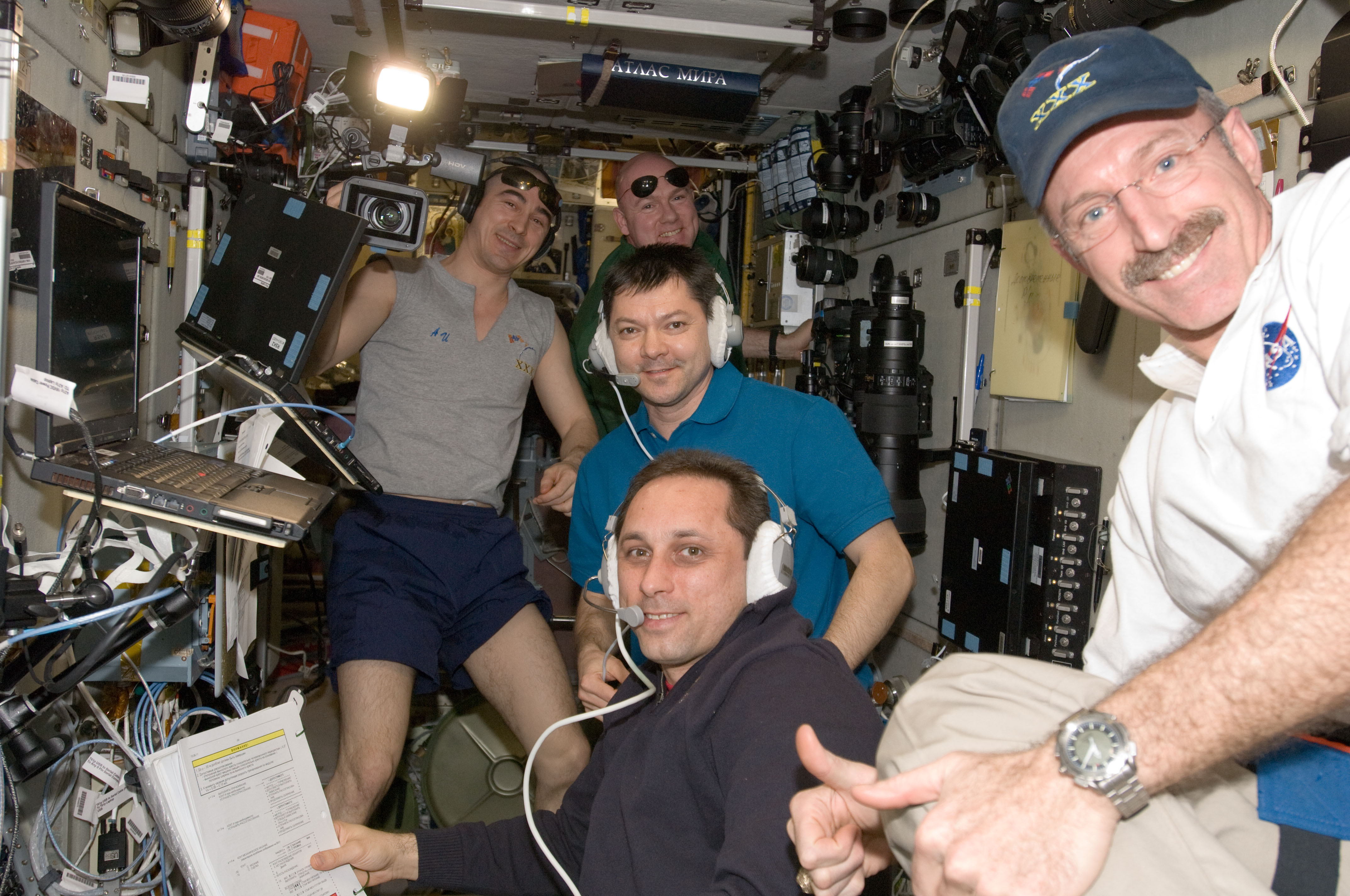 File Expedition 30 Crew In The Zvezda Module After Successful Docking Of Progress M