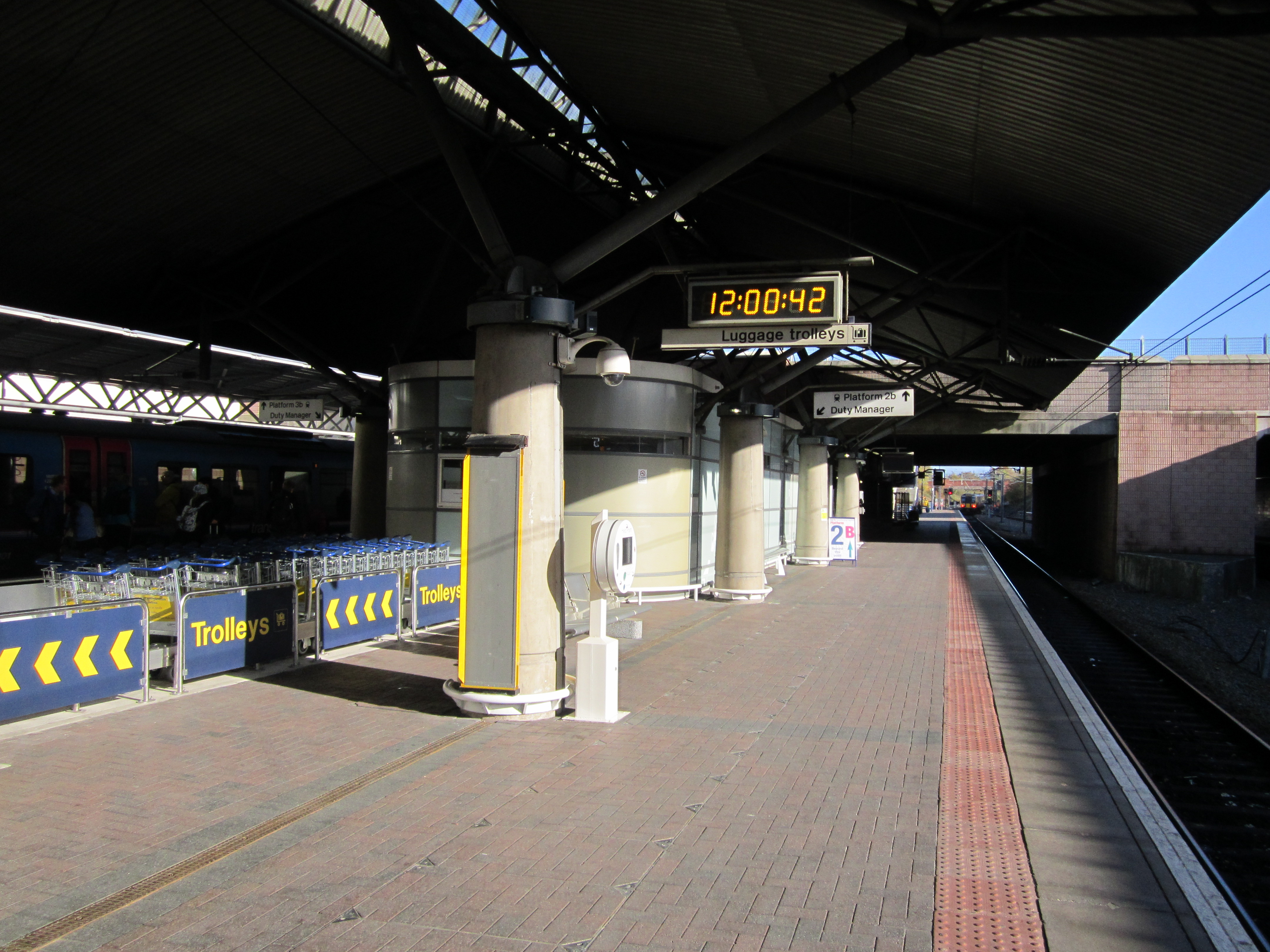 File:Manchester Airport railway station at noon jpg
