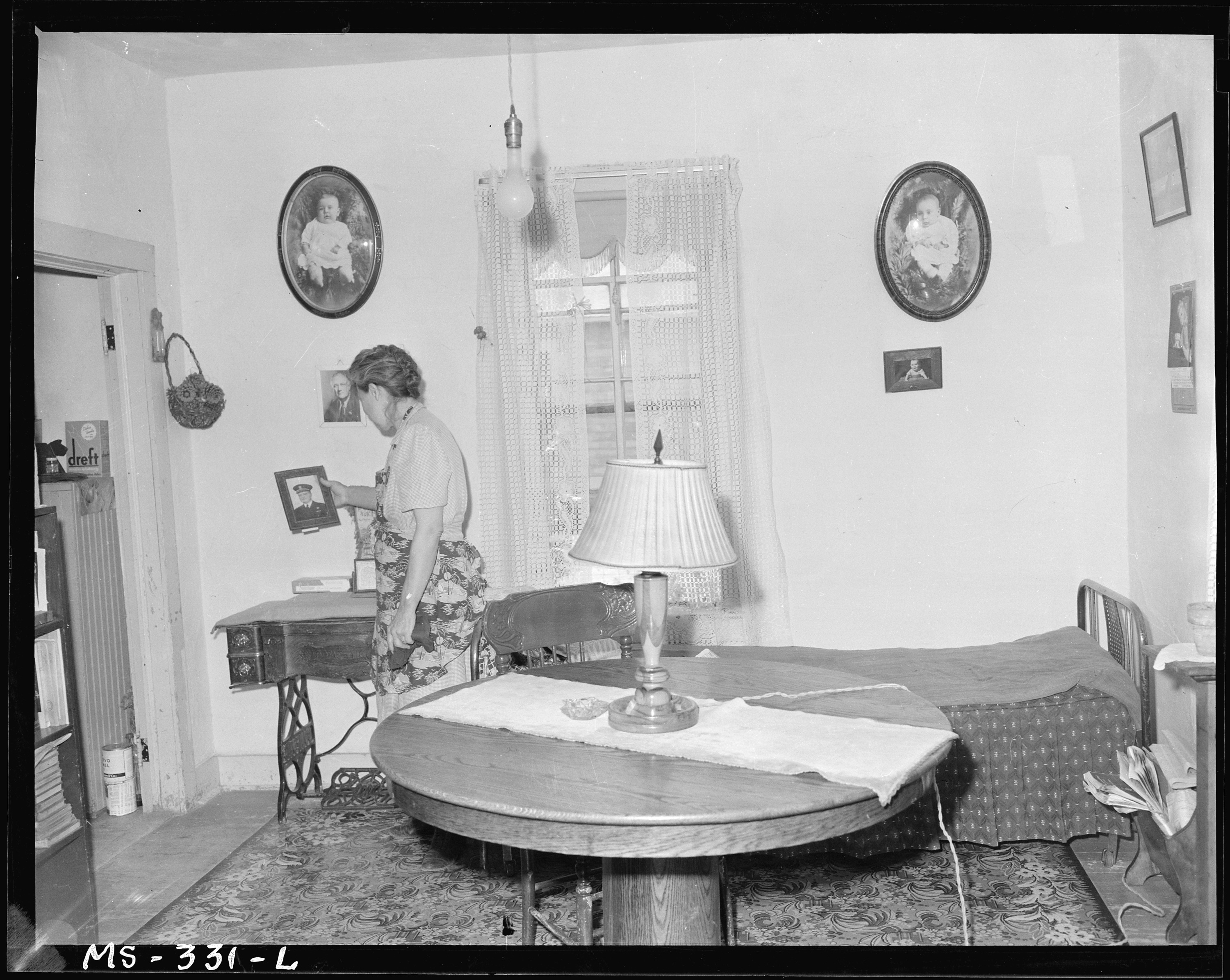FileMrs Molly Genoff Wife Of Miner In Living Room Her Home