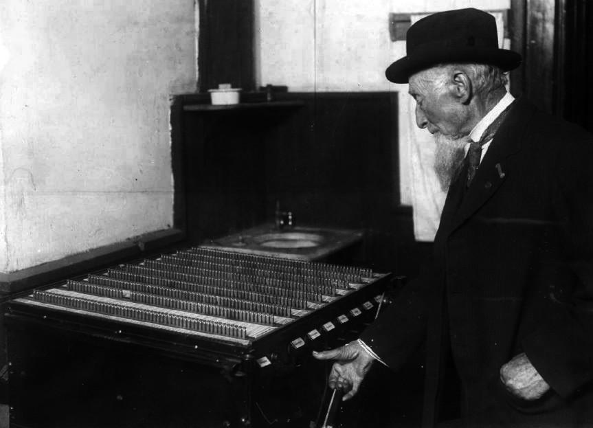 Photo of a seven ticket voting machine, Denver Colorado, 1912