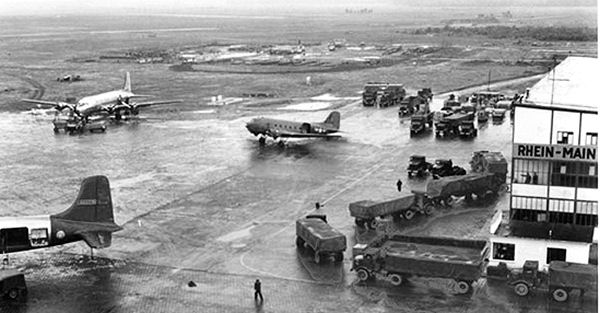 At Rhein-Main Air Base, Military and civilian supplies from Glessen Quartermaster Depot arrive in trucks of the 67th Transportation Company for transfer to waiting aircraft during the Berlin Airlift.