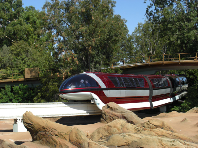 Monorail Red travels over the Finding Nemo Submarine Voyage in Tomorrowland.