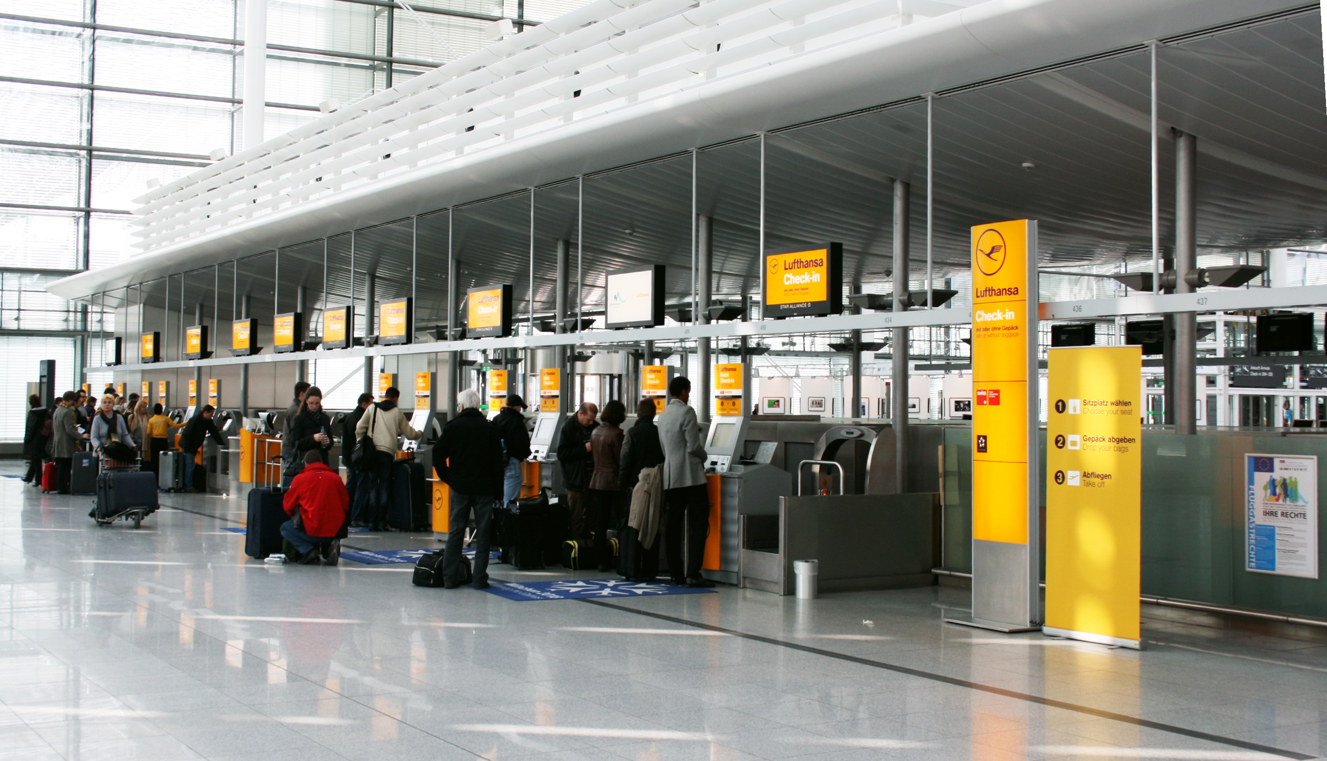 Luggage transit at munich airport terminal on different