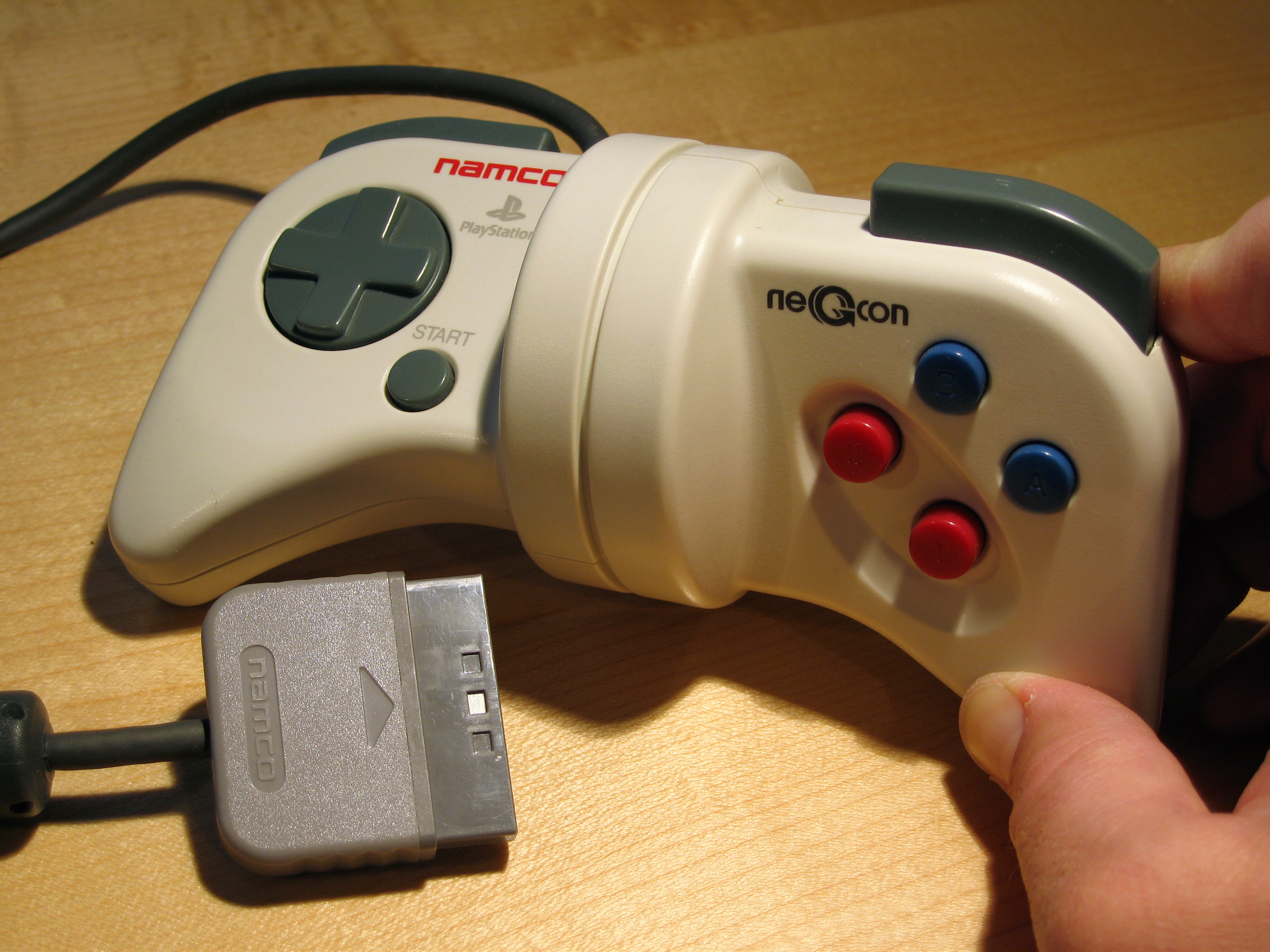 I think there once was a game pad with somewhat useful analog buttons It s by Namco for the PS1