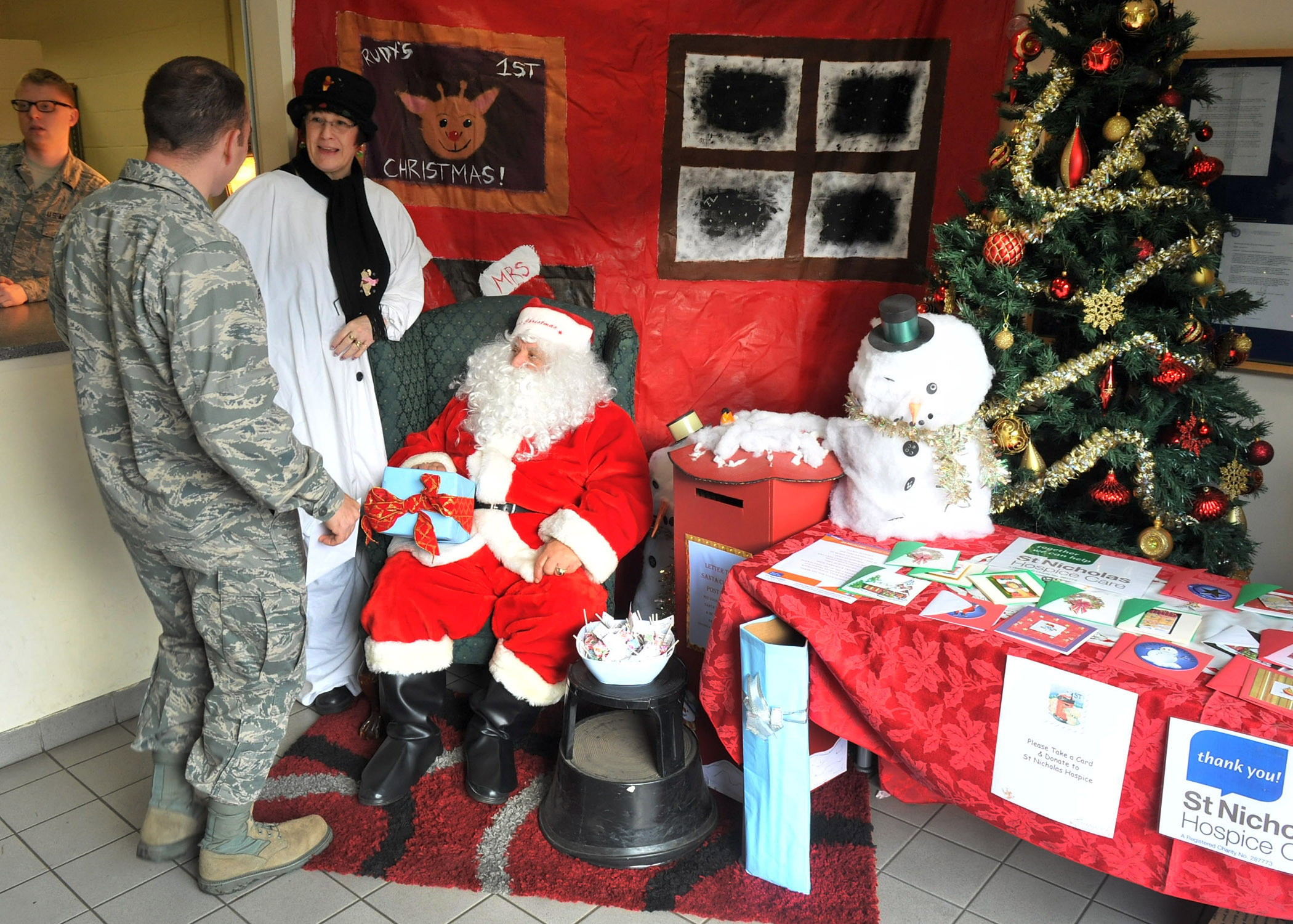 File Santa Claus greets Airmen families at post office F