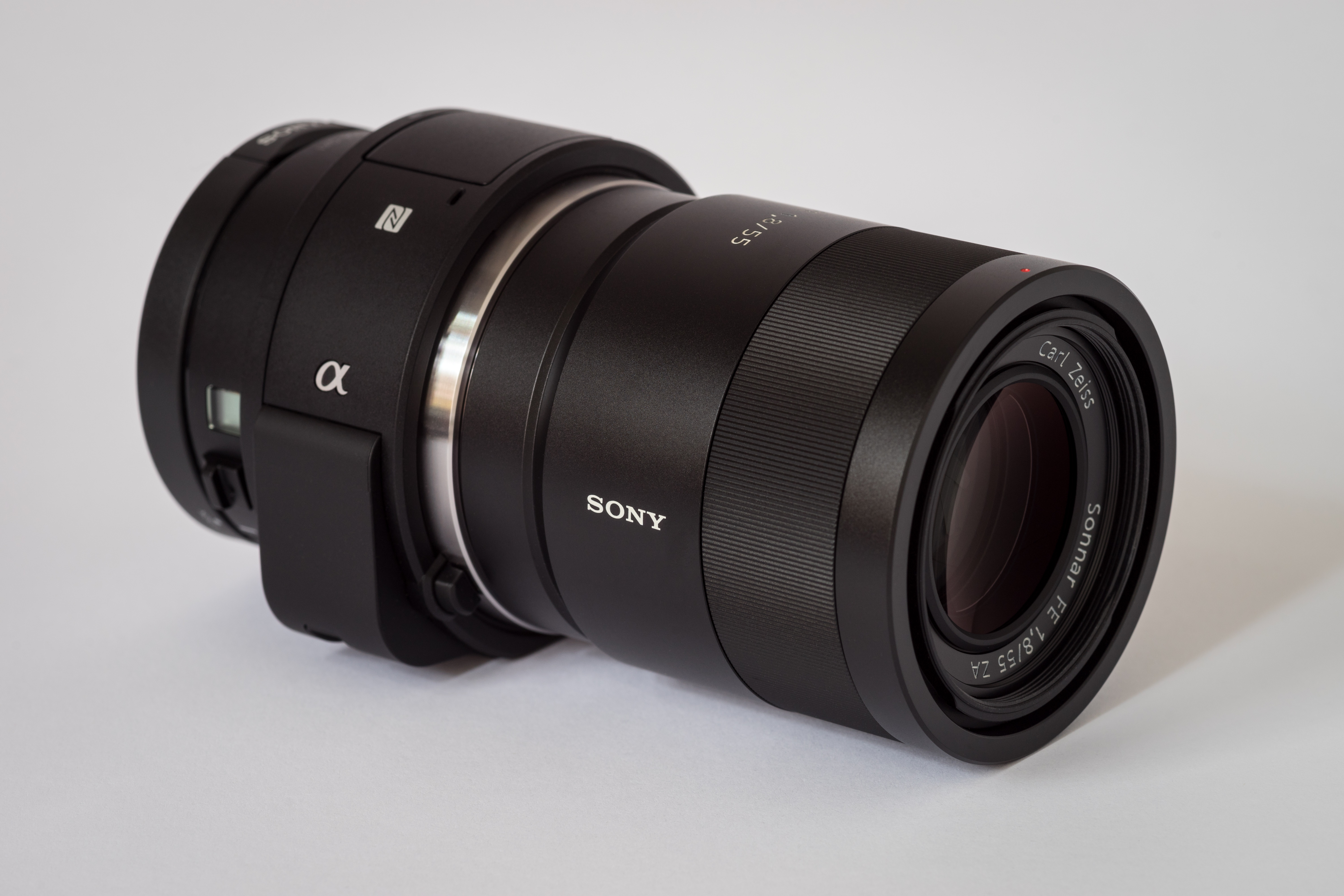 File Sony Alpha ILCE QX1 APS C frame camera with lens