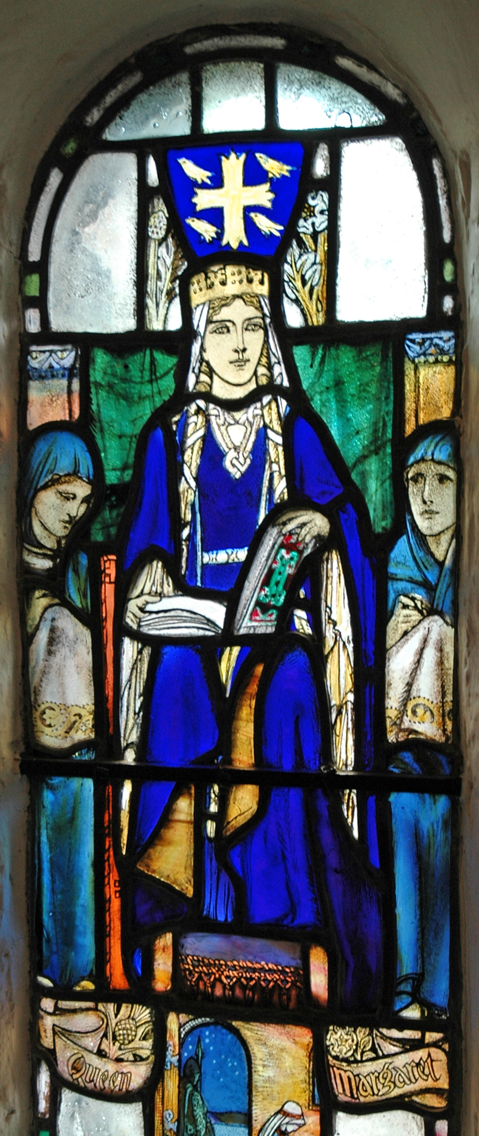 A blue-robed woman wearing a crown