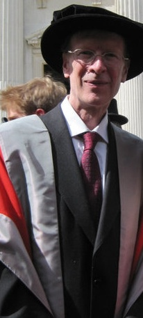 A photograph of Sir Andrew Wiles in his dress robes and cap.