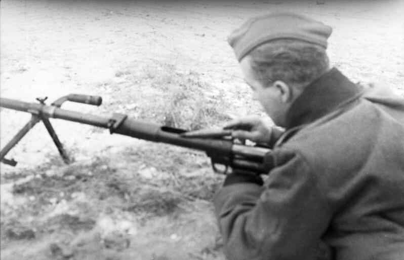 A German Soldier loading a captured PTRD