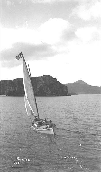 File:Small sailboat with American flag, ca 1912 (THWAITES