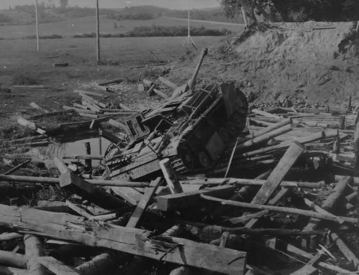 A StuG III destroyed on the bridge through Basya river