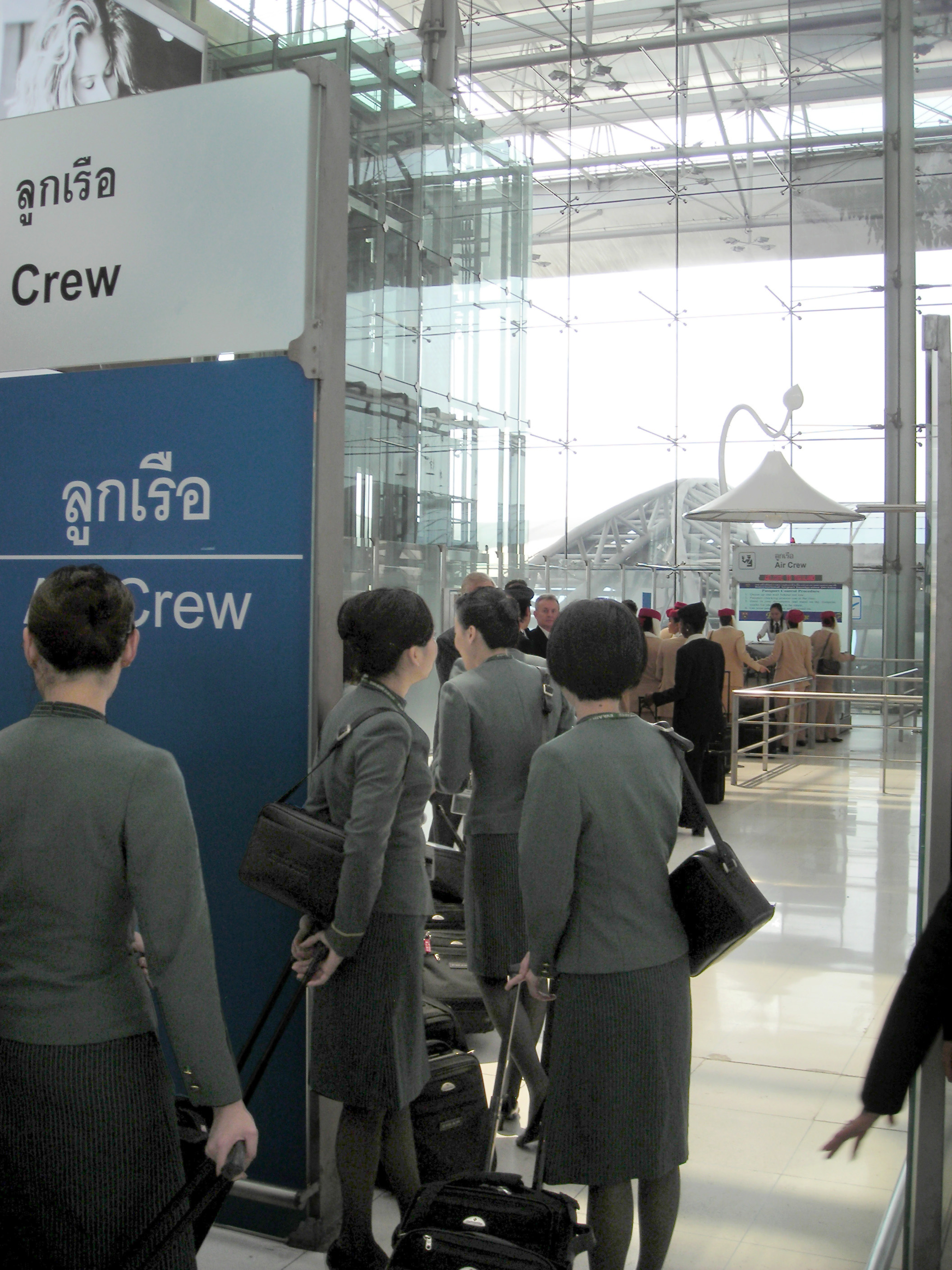 Good File:EVA Air Flight Attendants At A Aircrew Counter Of The Immigration  Bureau At Suvarnabhumi