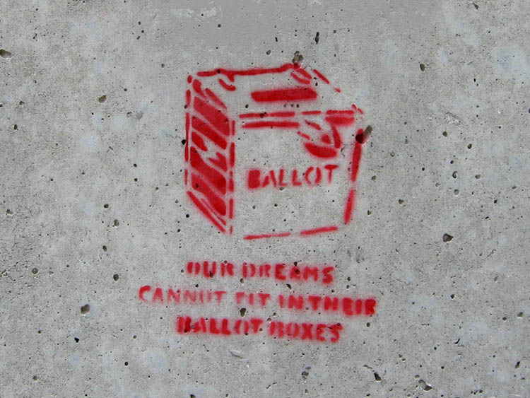 [Foto: Graffiti: Our dreams cannot fit in their ballot boxes]