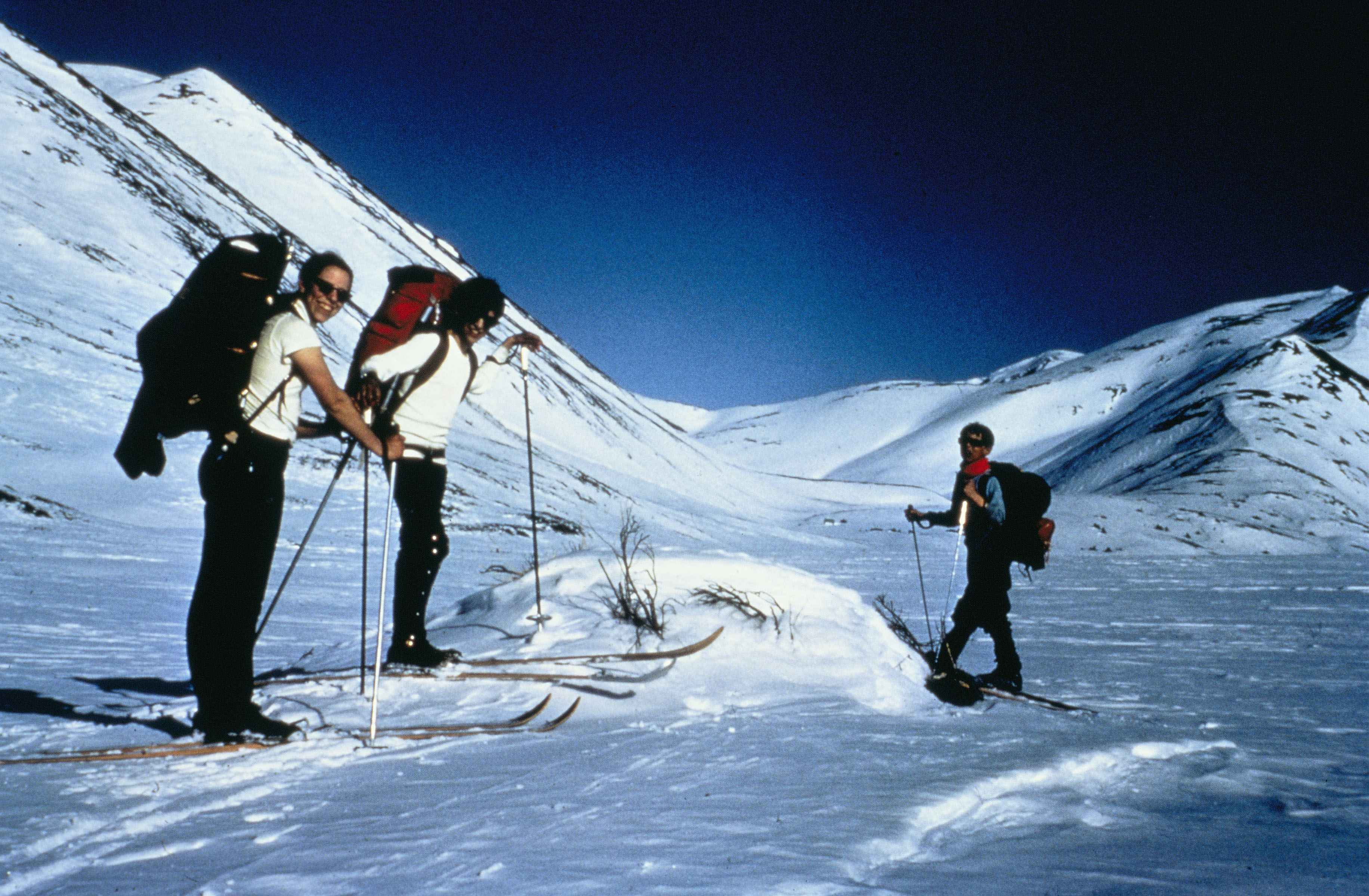 File recreational skiers in the mountains take breaks and enjoy skiing