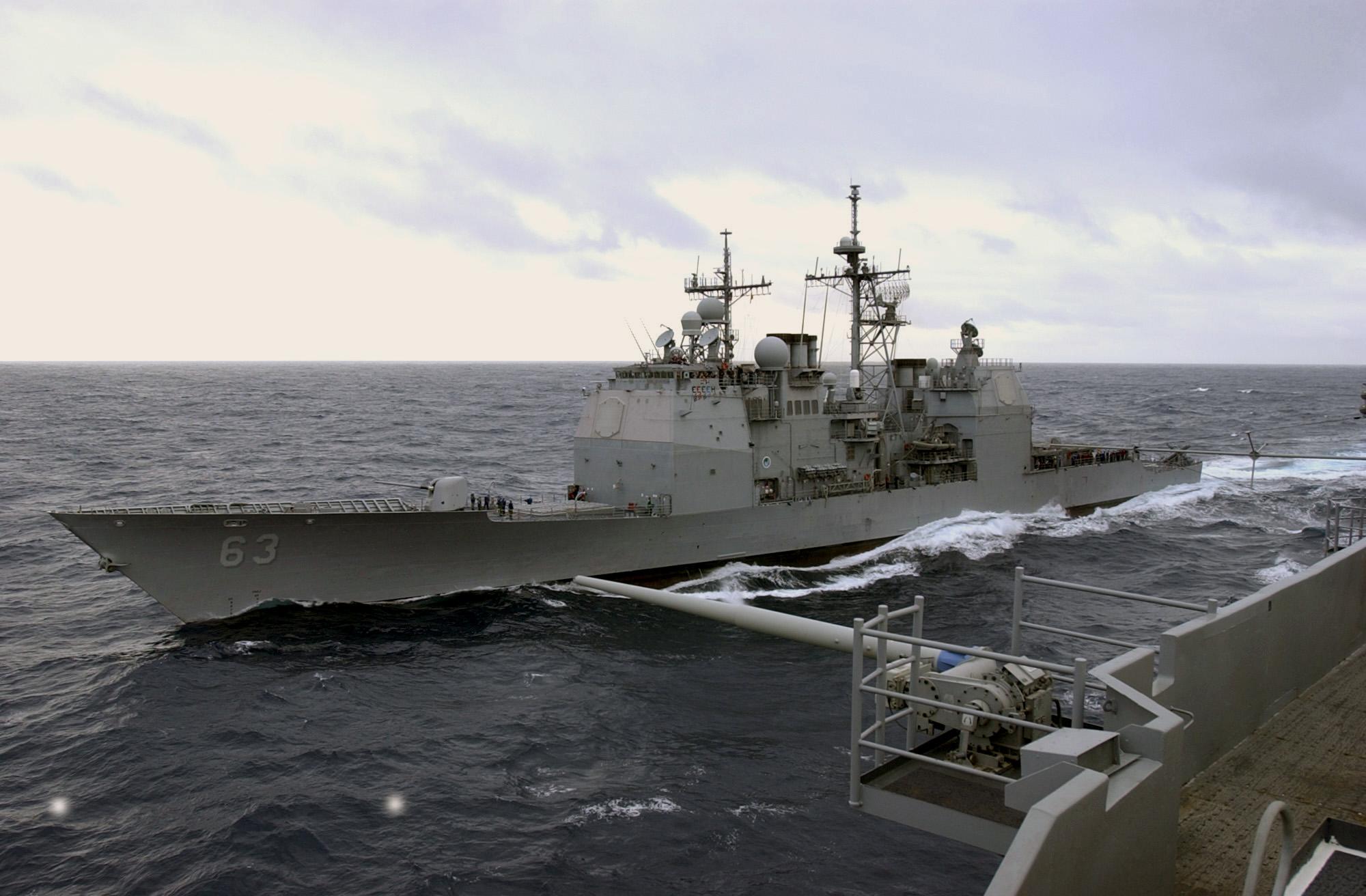 USS Cowpens pulls alongside USS Kitty Hawk (CV-63).