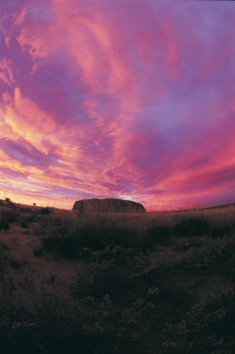Uluru at sunset By Toursim NT [Attribution], via Wikimedia Commons
