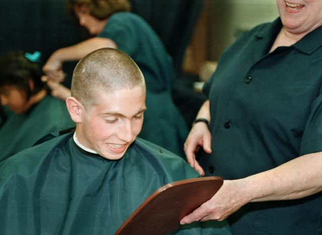 the haircut is called a skinhead (although the skinhead hairstyle was