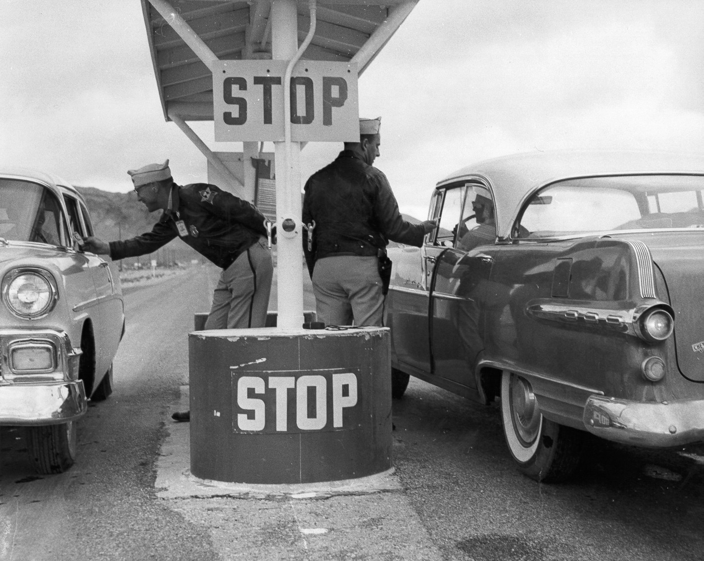 The Federal Services Incorporated (FSI) guards check passes for all vehicles entering or exiting the Nevada Test Site.