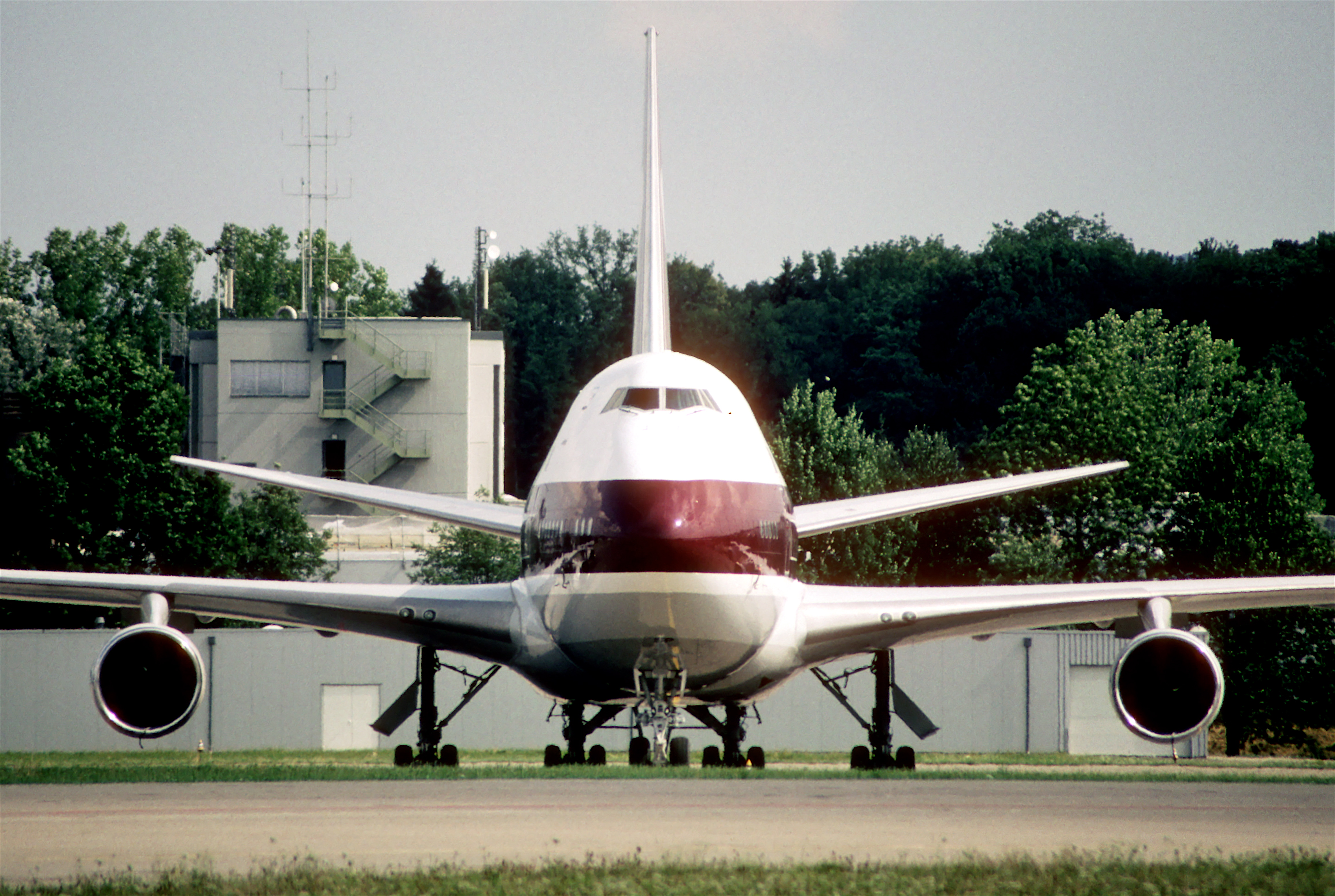 Forward view of aircraft, showing fuselage profile, two circular engines.
